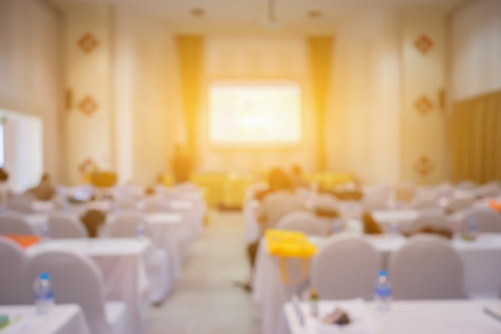 Blur background of Conference Room To Business Meeting ,Group of Business People Working in the Office,Group of young executives holding a work meeting in a conference room,student meet,vintage color