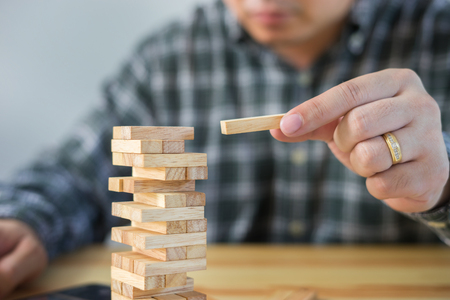 Planning, risk and strategy of project management in business, businessman and engineer gambling placing wooden block on a tower,construction with copy space,selective focus,vintage color Reklamní fotografie