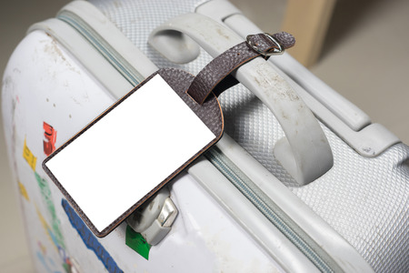 Close up of blank Leather luggage tag label on oid suitcase or bag with TRAVEL INSURANCE ,Can be used for montage or display your products,selective focus,vintage color Stock Photo