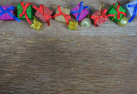 Christmas background with decorations and gift boxes on wooden board,selective focus