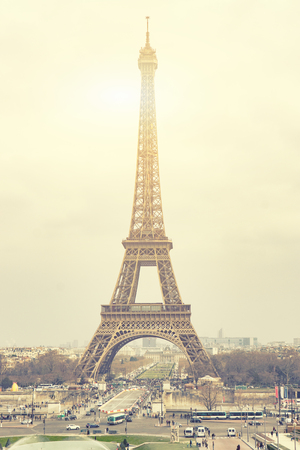 The Eiffel tower is one of the most recognizable landmarks in the world under sun light,selective focus,vintage color
