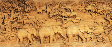 Carved Thai animals on the wood frame on white background,Lions, tigers, elephants, horses, cattle, deer, birds, trees, marking Thailand. Stock Photo - 72636123