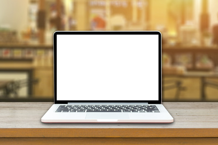 Open laptop computer  lying on a wooden table in cafe bar interior, portable net-book with copy space screen for your information content or text message, freelance ,internet,vintage color Imagens - 72636146
