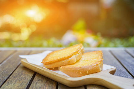 Sliced rye bread on a Board. On a wooden table. side view, for a breakfast,vintage color,selective focus
