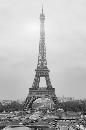 The Eiffel tower is one of the most recognizable landmarks in the world under sun light,selective focus,Black and white