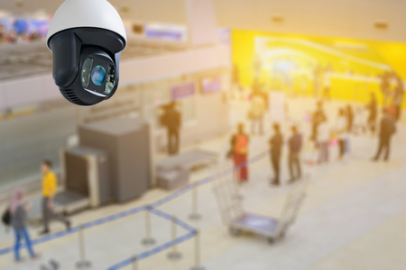 Closed-circuit television,Security CCTV camera or surveillance system in   background of Checkpoint - Body and bag Luggage Scan Machine ,Secure Airport Check In,vintage color Imagens - 73815909