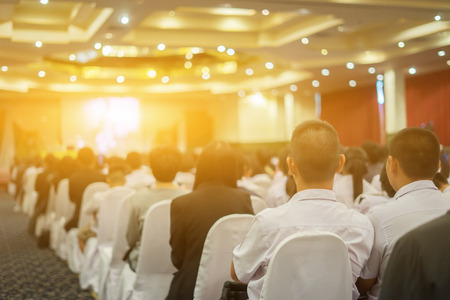 Student listening to Speaker Giving a Talk at Business Meeting marketing plan. Audience in the conference hall. Businessman and Entrepreneurship.unrecognizable people conference room,selective focus 写真素材
