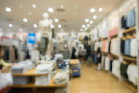 blurred abstract background of multicolored cotton clothing on the shelves of fashion and city shopping people crowd at marketplace shoe shop .vintage color Imagens