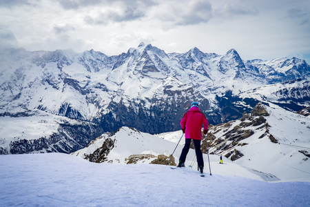 Skier skiing downhill in high mountains against sunshine,vintage color Stock Photo