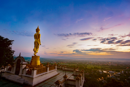Wat Phra That Khao Noi, Nan Province, Thailand, Golden Buddha statue standing on a mountain,City of cultural and natural tourism in the north,selective focus