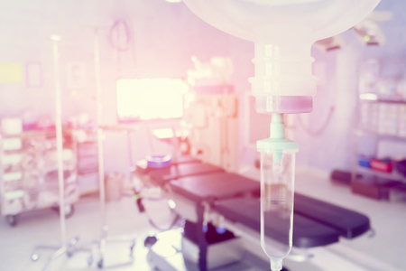 Close up 0.9 % Normal saline solution or sodium chloride drip for patient and infusion pump at Emergency ,operating room in hospital by doctor,Medical corridor concept,with copy space ,vintage color