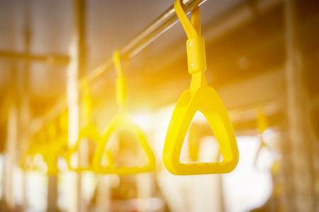 Handle on ceiling of bus, a train, MRT, prevent toppling.underground railway system,vintage color ,copy space Stock Photo