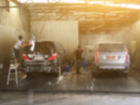 Blurred background of Worker washing car ,vintage color
