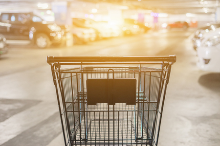 Abstract blurred photo of trolley in department store bokeh background,Shopping cart in supermarket car park Imagens