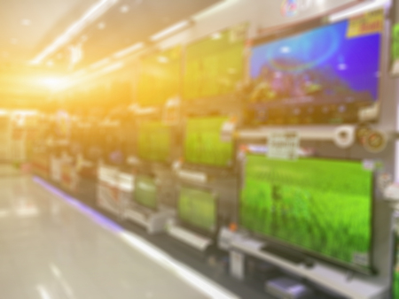 blurry of a shop selling household appliances and TVs was blurred for use as a background,vintage color Stock Photo