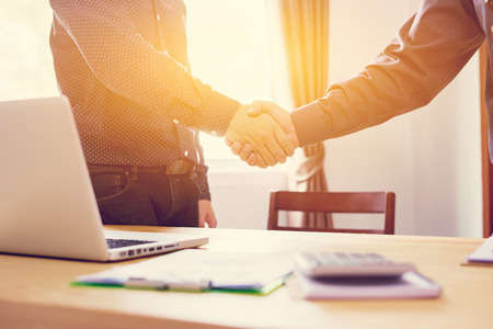 Business partnership marketing meeting concept. Image businessmans handshake. Successful businessmen handshaking after good deal.vintage color, Discussing Together Startup Idea.Working Online Project Imagens