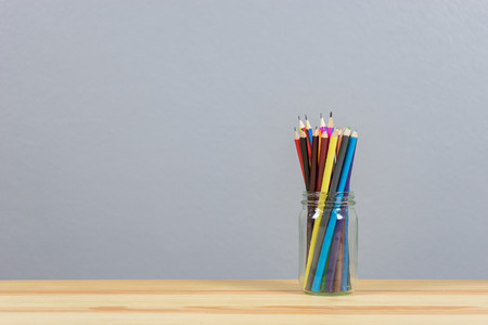 Assortment of colored pencils  Drawing on wood desk table,copy space ,selective focus