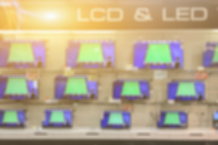 blurry of a shop selling household appliances and LED LCD TVs was blurred for use as a background,vintage color Imagens