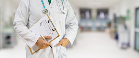 doctor holding prescription application form  and pen while consulting patient,stethoscope on neck,medical concept ,for banner background,selective focus,vintage tone color,copy space Imagens