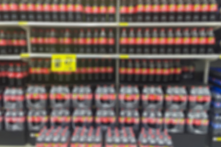 abstract blur view of juice beverage sparkling water product on refrigerator shelves in supermarket. Imagens