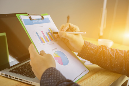Business team meeting present.professional investor working with new startup project. Finance managers task. businessman pointing on pie charts showing gold in morning light,marketing plan analysis.