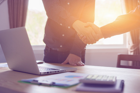 Great job,Sealing a deal,Successful business,Handshake,Businessman join together,Good agreement.two business people shaking hands standing at the working place,selective focus,Vintage