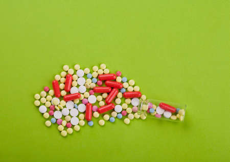 colored vitamins on paper