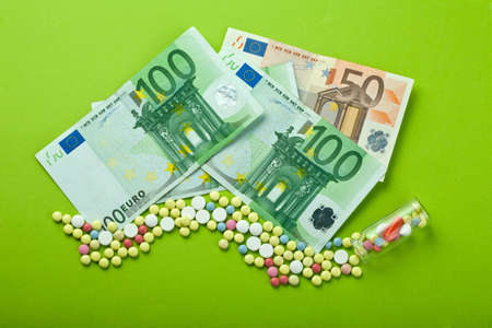 Pills and tablets with Euro paper currency