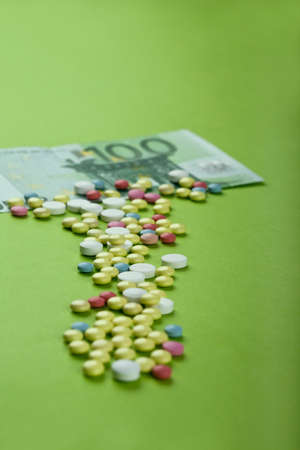 Pills and tablets with Euro bill on paper