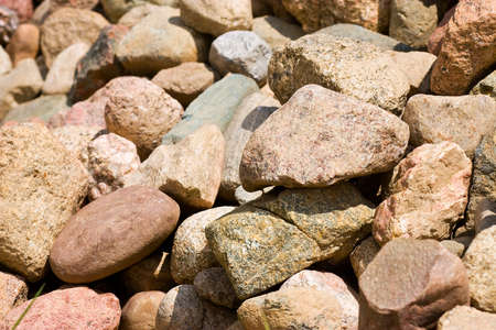 pile of stones of different sizes background Stock Photo