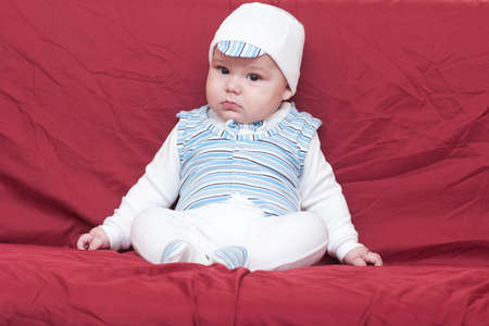 cute boy in cap sitting in the studio Stock Photo - 16434823