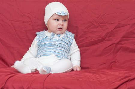 cute boy in cap sitting in the studio Stock Photo - 16434867