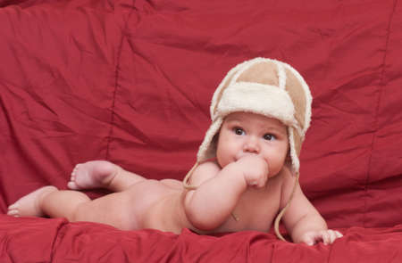 boy in winter hat and boots is in the studio