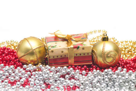 Shiny miniature Christmas present with beads and balls Stock Photo