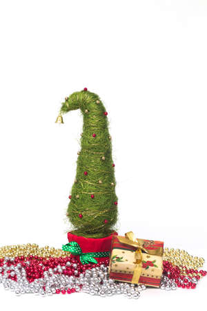 Shiny miniature Christmas tree made of sisal with beads and present