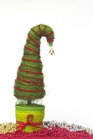 Shiny miniature Christmas tree made of sisal with beads