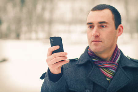 expresses: Man expresses emotion when talking on a cell mobile phone Stock Photo