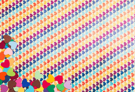 corner of multicolored paper hearths  on multicolored paper Stock Photo