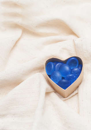 stone heart in cardboard box in the form of heart on linen fabric Stock Photo - 17174491