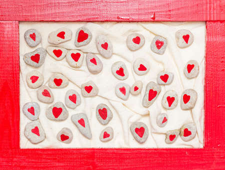 stones painted with red hearts in the red frame Stock Photo - 17174508