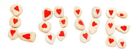 word love laid out from stones on white Stock Photo - 17174483