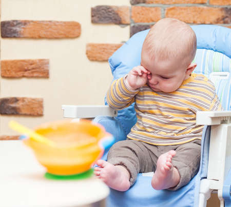 Eating little boy is looking very angry and annoyed Stock Photo - 17181985