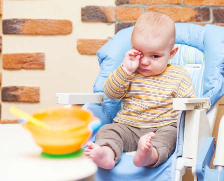 Eating little boy is looking very angry and annoyed Stock Photo - 17181983