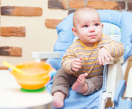 Eating little boy is looking very angry and annoyed Stock Photo - 17181989