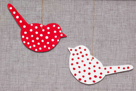 two wooden multicolored birds on grey background Stock Photo - 17229554