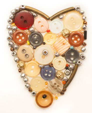 Colorful buttons heart on white photo