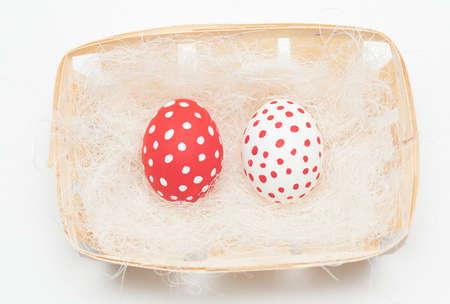 braiding: colorful easter eggs on braiding basket with sisal
