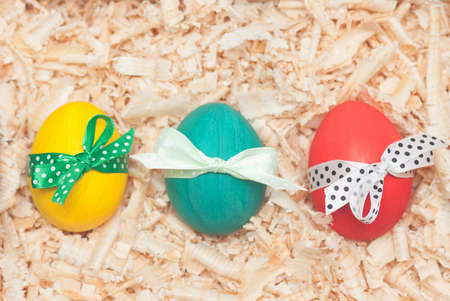 colorful easter eggs with sawdust Stock Photo