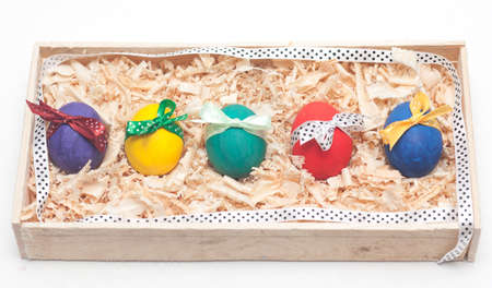 braiding: colorful easter eggs on braiding basket with sawdust
