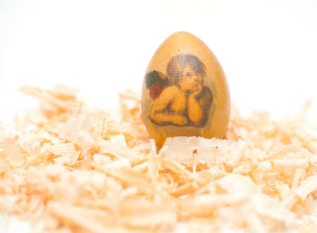 easter egg made decoupage methods on sawdust
